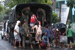 Residents ride a military truck as they evacuate to safer grounds in preparation for the coming of Typhoon Kammuri in Legazpi, Albay province, southeast of Manila, Philippines on Monday Dec. 2, 2109. The Philippines' main island, including the national capital, Manila, is under a tropical cyclone warning for a typhoon forecast to hit Monday night into Tuesday. (AP Photo)