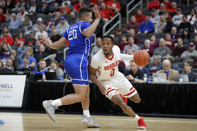 Bradley's Danya Kingsby (0) heads to the basket past Drake's Jonah Jackson (20) during the first half of an NCAA college basketball game in the semifinal round of the Missouri Valley Conference men's tournament Saturday, March 7, 2020, in St. Louis. (AP Photo/Jeff Roberson)