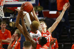 Syracuse forward Bourama Sidibe, bottom,, and forward Marek Dolezaj (21) try to block the shot of Virginia forward Mamadi Diakite (25) during the first half of an NCAA college basketball game in Charlottesville, Va., Saturday, Jan. 11, 2020. (AP Photo/Steve Helber)