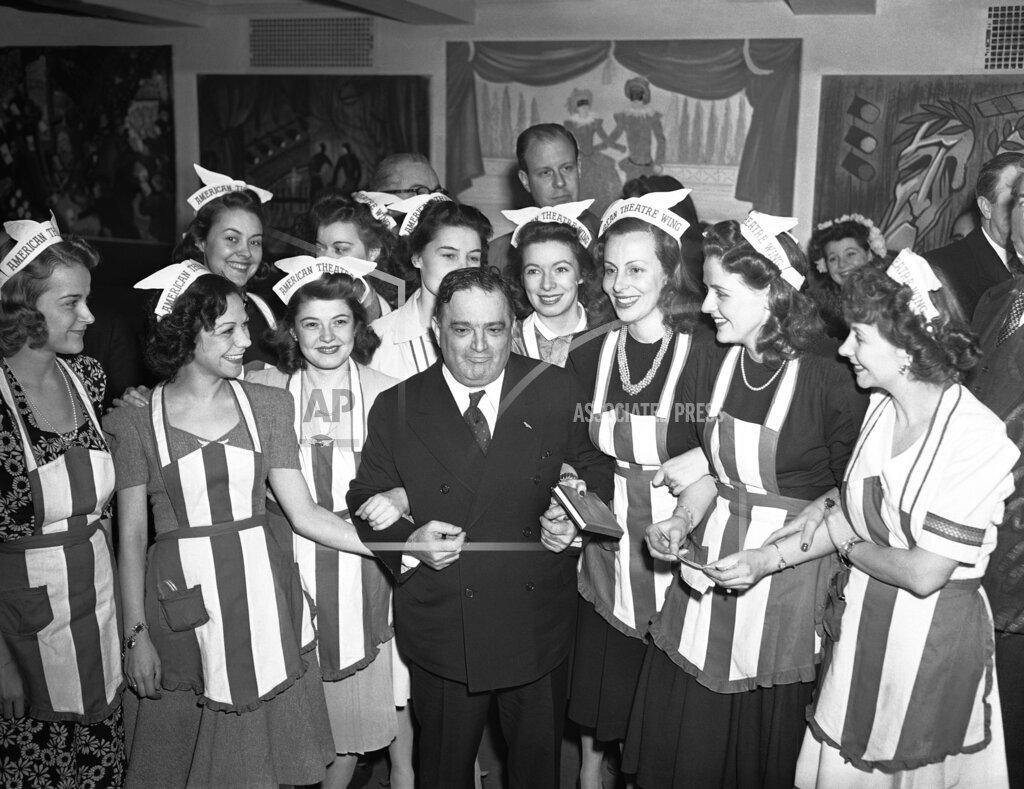 Watchf AP A  NY USA APHS311874 Mayor Fiorella LaGuardia surrounded hostesses
