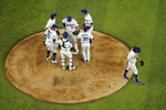 Los Angeles Dodgers starting pitcher Tony Gonsolin leaves the game against the Atlanta Braves during the fourth inning in Game 7 of a baseball National League Championship Series Sunday, Oct. 18, 2020, in Arlington, Texas. (AP Photo/David J. Phillip)