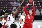 Georgia center Jenna Staiti (14) shoots as South Carolina forward Aliyah Boston (4) defends during the second half of an NCAA college basketball game Thursday, Jan. 21, 2021, in Columbia, S.C. (AP Photo/Sean Rayford)