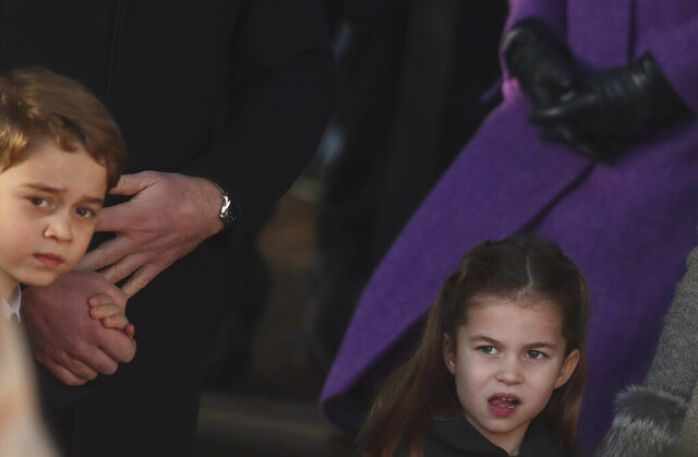 Britain's Prince George and Princess Charlotte, children of the Duke and Duchess of Cambridge after attending a Christmas day service at the St Mary Magdalene Church in Sandringham in Norfolk, England, Wednesday, Dec. 25, 2019. (AP Photo/Jon Super)