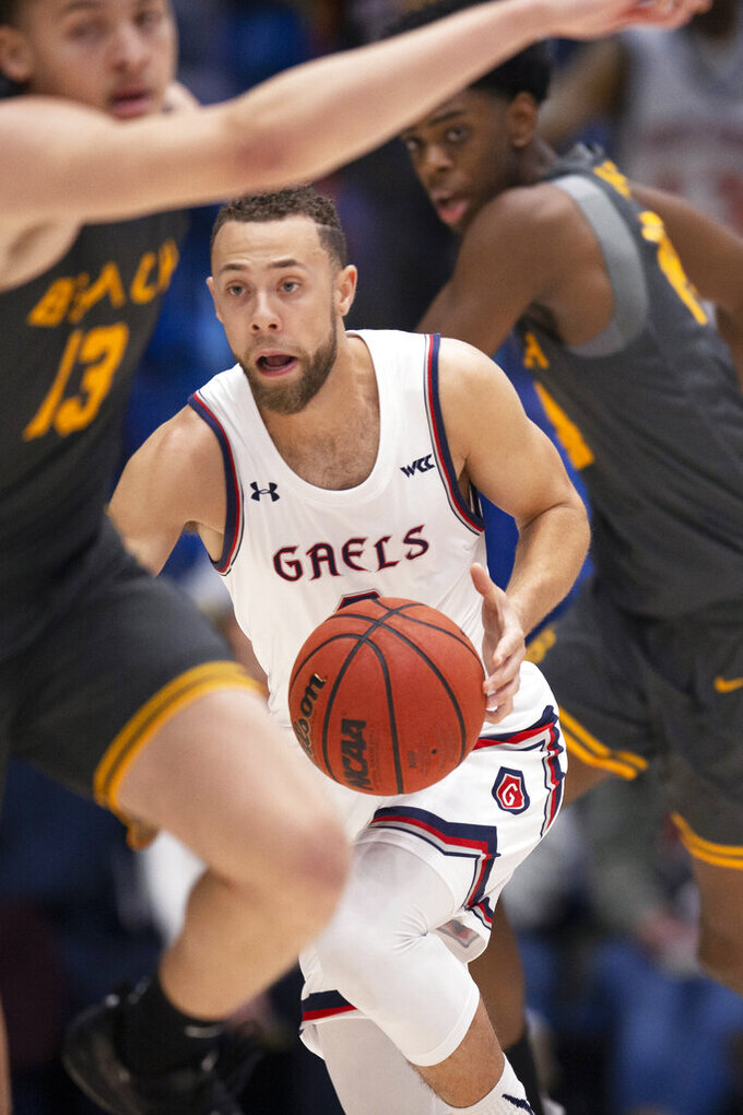 Saint Mary's guard Jordan Ford heads upcourt with the ball after making the steal from Long Beach State center Joshua Morgan, rear, during the first half of an NCAA college basketball game Thursday, Nov. 14, 2019, in Moraga, Calif. (AP Photo/D. Ross Cameron)