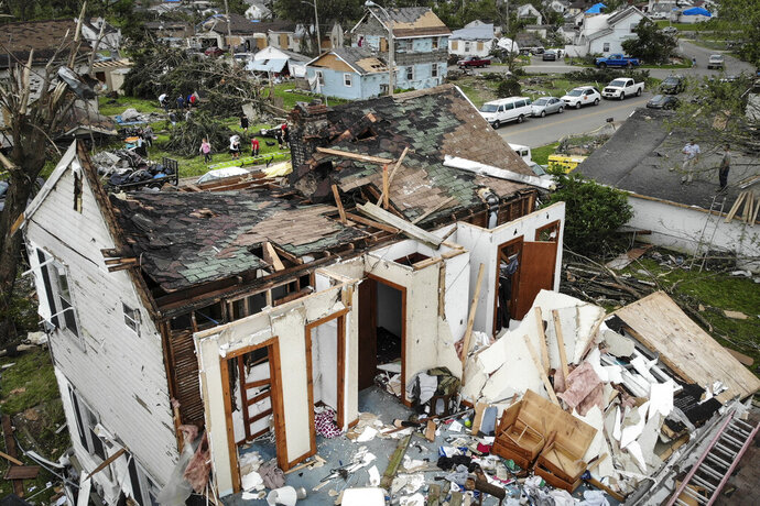Repair and cleaning efforts begin on a neighborhood damaged by a tornado storm system that passed through the area, destroying homes and cutting off access to utilities, Wednesday, May 29, 2019, in Dayton, Ohio. Tens of thousands of Ohio residents were still without power or water Wednesday in the aftermath of strong tornadoes that spun through the Midwest.  (AP Photo/John Minchillo)