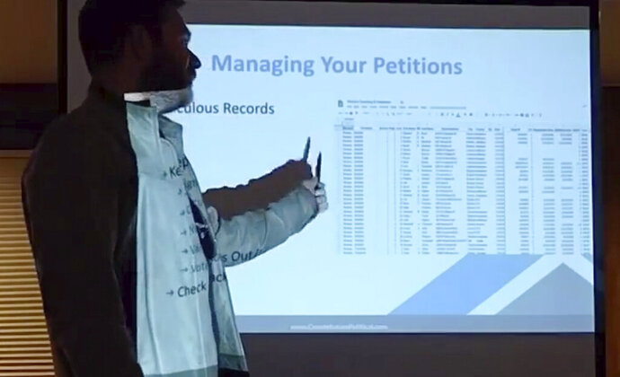 In this frame grab of an April 11, 2019, video provided by Ben Engen of Denver-based Constellation Political Consulting, Engen, a Republican consultant, conducts a training session on how to organize and execute recall campaigns against elected Democratic lawmakers for a group of GOP activists in Buena Vista, Colo. Once reserved for corrupt or inept elected officials, recall campaigns have become a political weapon for Republicans who are trying to undo their losses to Democrats in statewide regular elections. (Constellation Political Consulting via AP)