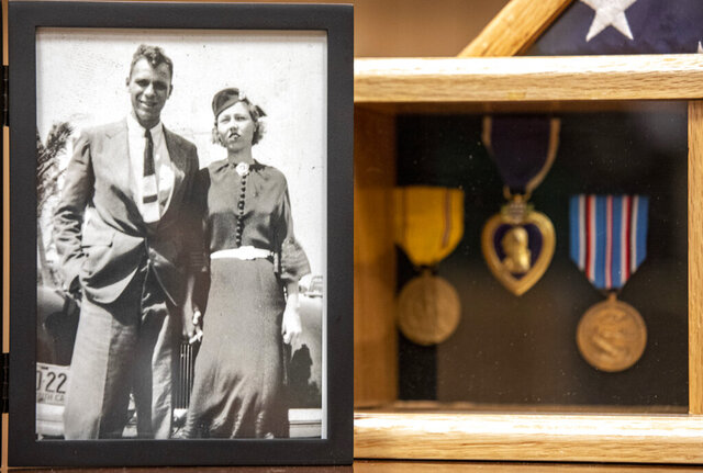 A photograph of Lt. j.g. William Ennis Spencer, Jr. with his wife Ester from the 1930s sits next to his medals at the American Legion Post in Goose Creek, S.C. on Friday, Nov. 6, 2020.   Nearly 2 million Purple Hearts have been awarded to brave Americans who have been wounded or killed in the line of duty, and it is one of the highest honors that can be bestowed to veterans. (Andrew J. Whitaker/The Post And Courier via AP)