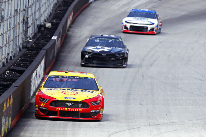 Driver Joey Logano (22) leads others down the back straight during practice for a NASCAR Cup Series auto race, Friday, Aug. 16, 2019, in Bristol, Tenn. (AP Photo/Wade Payne)
