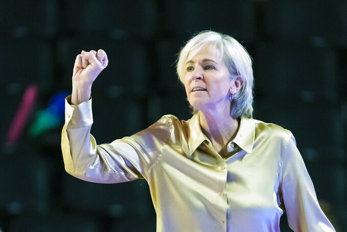 "FILE - In this Nov. 17, 2019, file photo, Georgia Tech coach Nell Fortner gestures during an NCAA college women's basketball game against Georgia, in Athens, Ga. Georgia Tech wants to make sure its athletes take  time to vote in November. The school said Thursday, June 4, 2020, that nine teams will cancel all mandatory activities on the Nov. 3 to recognize the importance of casting a ballot. ""I lead a group of strong, young women, student-athletes from all backgrounds and nationalities,"" Fortner said. ""To my African-American players and staff, I stand behind you and beside you as our nation continues to find its way for total equality for African-American people. On November 3, 2020, all of our voices can be heard and I will encourage my student-athletes to be heard.""(AP Photo/John Amis, File)"