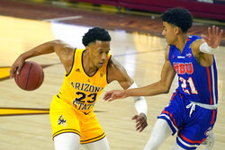 Arizona State forward Marcus Bagley (23) drives against Houston Baptist guard Pedro Castro during the first half of an NCAA college basketball game, Sunday, Nov. 29, 2020, in Tempe, Ariz. (AP Photo/Rick Scuteri)