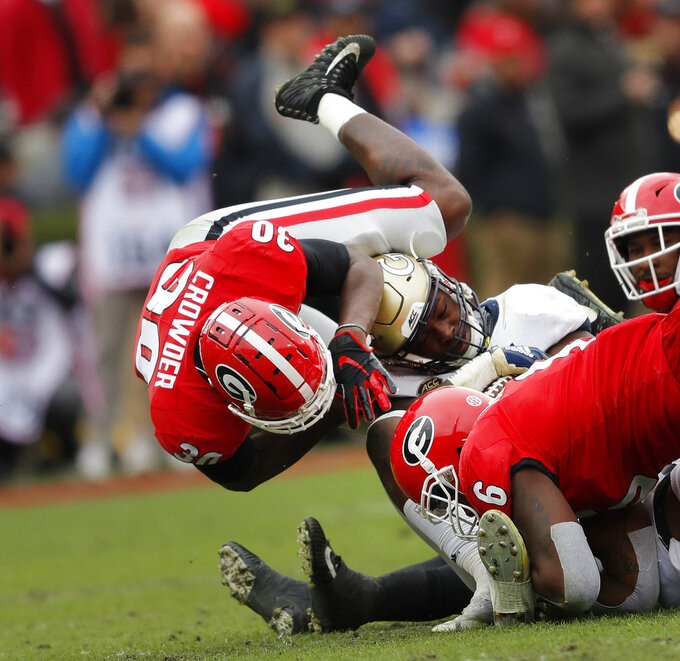 Georgia Tech running back Jerry Howard (15) is tackled by Georgia linebackers Natrez Patrick (6) and Tae Crowder (30) during the first half of an NCAA college football game Saturday, Nov. 24, 2018, in Athens, Ga. Georgia won 45-21. (AP Photo/John Bazemore)