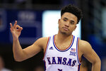 "FILE - In this March 4, 2020, file photo, Kansas guard Devon Dotson celebrates a 3-point basket during the second half of the team's NCAA college basketball game against TCU in Lawrence, Kan. Dotson is entering the NBA draft after leading the Big 12 Conference in scoring his sophomore season. ""In basketball, this has always been my ultimate dream and my time at KU has prepared me,"" Dotson said Monday, April 13, 2020, in a news release.(AP Photo/Orlin Wagner, File)"