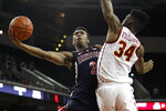 Arizona's Brandon Williams shoots next to Southern California's Victor Uyaelunmo during the second half of an NCAA college basketball game Thursday, Jan. 24, 2019, in Los Angeles. USC won 80-57. (AP Photo/Jae C. Hong)