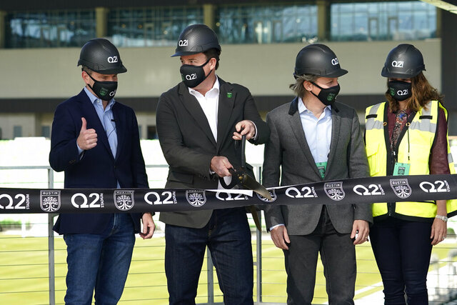 Q2 Holdings Inc. CEO Matt Flake, left, and Austin FC majority owner Anthony Precourt, second from left, take part in a ribbon cutting as the team's new stadium is named Q2 Stadium, Monday, Jan. 25, 2021, in Austin, Texas. (AP Photo/Eric Gay)