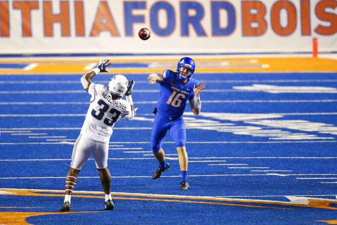 Boise State quarterback Jack Sears (16) throws the ball downfield over the pressure of Utah State linebacker Kevin Meitzenheimer (33) in the second half of an NCAA college football game Saturday, Oct. 24, 2020, in Boise, Idaho. Boise State won 42-13 (AP Photo/Steve Conner)