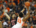 Louisville's Jordan Nwora, left, defends Syracuse's Elijah Hughes, right, during the first half of an NCAA college basketball game in Syracuse, N.Y., Wednesday, Feb. 20, 2019. (AP Photo/Nick Lisi)