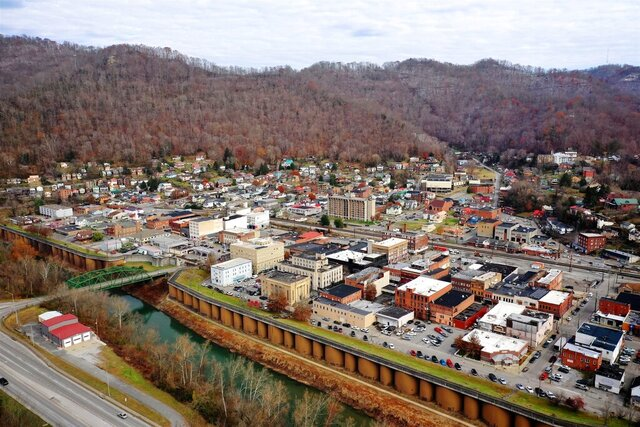 FILE- In this Thursday, Nov. 29, 2018 photo Williamson, W.Va., is seen across the border from Kentucky. West Virginia relies the most of any U.S. state on federal money that is guided by the once-a-decade census, according to a new update of a long-running study. Federal funding represents more than 16% of the personal income in West Virginia, according to an update released this week to the study led by Andrew Reamer at George Washington University. (AP Photo/Tyler Evert, File)