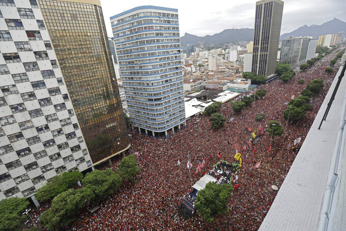 Players of Brazil's Flamengo parade down the street at their arrival in Rio de Janeiro, Brazil, Nov. 24, 2019. Flamengo overcame Argentina's River Plate 2-1 in the Copa Libertadores final match in Lima to win its second South American title. (AP Photo/Silvia Izquierdo)