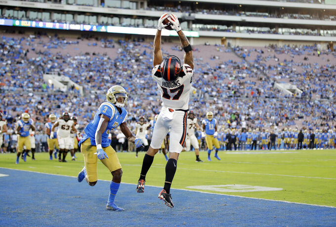 Oregon State wide receiver Isaiah Hodgins (17) makes a touchdown catch next to UCLA defensive back Rayshad Williams (3) during the first half of an NCAA college football game Saturday, Oct. 5, 2019, in Pasadena, Calif. (AP Photo/Marcio Jose Sanchez)
