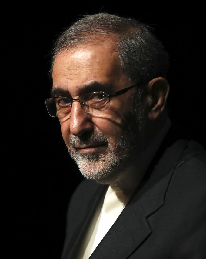 In this Jan. 30, 2020, photo, Ali Akbar Velayati, adviser to the Iranian supreme leader Ayatollah Ali Khamenei, gives a press conference, in Tehran, Iran. In hard-hit Iran, state-run TV announced that Velayati was quarantined at home after testing positive for the virus. He is a close, trusted adviser to the 80-year-old leader of the Islamic Republic, who was recently seen wearing disposable gloves at a tree-planting ceremony, apparently out of caution about the virus. (AP Photo/Vahid Salemi)