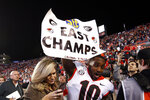 Georgia wide receiver Kearis Jackson (10) celebrates Georgia clinching the Southeastern Conference East after they defeated Auburn 21-14 in an NCAA college football game, Saturday, Nov. 16, 2019, in Auburn, Ala. (AP Photo/Butch Dill)