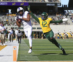 FILE - In this Oct. 31, 2020, file photo, TCU wide receiver Quentin Johnston, left, pulls in a pass close to the end zone over Baylor cornerback Kalon Barnes, right, in the first half of an NCAA college football game, in Waco, Texas.  The Big 12 will have nothing like the Red River rivalry on the second Saturday in October once Texas and Oklahoma make their move to the Southeastern Conference. There will even be the renewal of some old but not as long standing feuds, and maybe some new ones when BYU, Central Florida, Cincinnati and Houston begin Big 12 play within the next two to three seasons.  (Rod Aydelott/Waco Tribune-Herald via AP, File)
