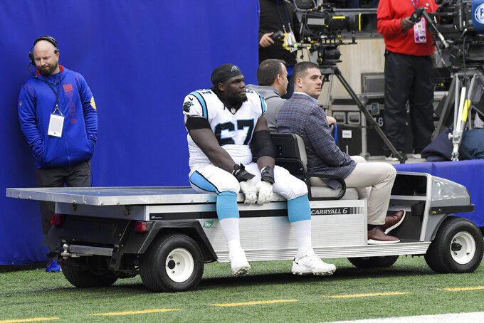Carolina Panthers guard John Miller (67) is carted off the field during the second half of an NFL football game against the New York Giants, Sunday, Oct. 24, 2021, in East Rutherford, N.J. (AP Photo/Bill Kostroun)