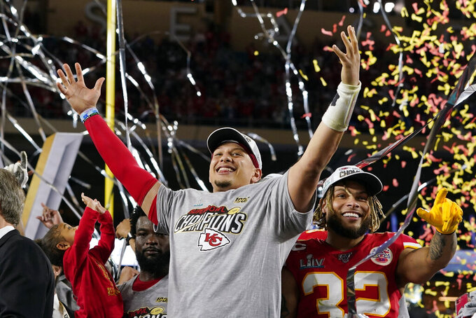 FILE - In this Feb. 2, 2020, file photo, Kansas City Chiefs' Patrick Mahomes, left, and Tyrann Mathieu celebrate after defeating the San Francisco 49ers in the NFL Super Bowl 54 football game in Miami Gardens, Fla. Teams could afford recent contracts like the megabucks given to Mahomes and Joey Bosa under normal circumstances. Because of economic effects from the pandemic, future player deals and a salary cap that will be adjusted due to some monetary setbacks, upcoming free agents might find the marketplace tighter. (AP Photo/David J. Phillip, File)