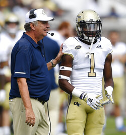 Georgia Tech head coach Paul Johnson speaks with Georgia Tech running back Qua Searcy before a play during the first half of an NCAA football game against Bowling Green, Saturday, Sept. 29, 2018, in Atlanta. (AP Photo/Mike Stewart)