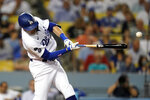Los Angeles Dodgers' AJ Pollock hits a two-run single during the third inning of the team's baseball game against the Pittsburgh Pirates on Tuesday, Aug. 17, 2021, in Los Angeles. (AP Photo/Marcio Jose Sanchez)