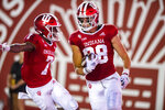 Indiana tight end A.J. Barner, right, celebrates in the end zone after scoring a touchdown during the second half of the team's NCAA college football game against Idaho, Saturday, Sept. 11, 2021, in Bloomington, Ind. (AP Photo/Doug McSchooler)