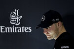 Mercedes driver Valtteri Bottas of Finland arrives to a press conference at the Formula One Bahrain International Circuit in Sakhir, Bahrain, Thursday, March 28, 2019. The Bahrain Formula One Grand Prix will take place on Sunday. (AP Photo/Hassan Ammar)