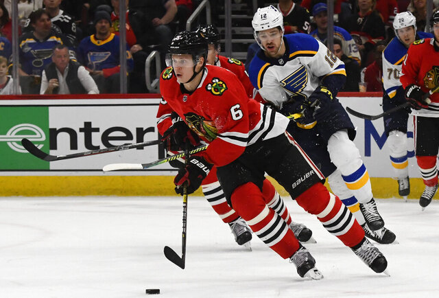 FILE - In this March 8, 2020, file photo, Chicago Blackhawks defenseman Olli Maatta (6) moves the puck away from St. Louis Blues left wing Zach Sanford (12) during the first period of an NHL hockey game in Chicago. The Los Angeles Kings have acquired Maatta from the Blackhawks in a trade for minor league forward Brad Morrison. The Kings announced the deal Sunday, Oct. 4, 2020, to acquire Maatta, a two-time Stanley Cup champion with Pittsburgh. (AP Photo/Matt Marton, File)