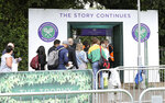 In this Tuesday, July 9, 2019 tennis fans wait in line for tickets to enter the Wimbledon Tennis Championships in London. For many the Wimbledon experience starts in a tent as they gather in a small park across from the tournament grounds to camp out, some for days, in the hope of getting a ticket to Centre Court as they are released each day.