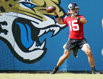 Jacksonville Jaguars quarterback Gardner Minshew II (15) throws a pass during an NFL football workout, Thursday, Aug. 13, 2020, in Jacksonville, Fla. Ben McAdoo (Giants) is Jacksonville's new quarterback's coach and Jay Gruden (Washington) is the team's offensive coordinator. Together, they have been tasked with helping Minshew and one of the league's youngest offenses take huge strides after missing months of on-field work during the offseason because of the coronavirus pandemic. (AP Photo/John Raoux)