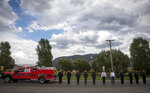 Local law enforcement prepare to salute Marine Lance Cpl. Rylee McCollum during his procession, in Jackson, Wyo., Friday, Sept. 10, 2021. McCollum was one of the service members killed in Afghanistan after a suicide bomber attacked Hamid Karzai International Airport on Aug. 26. (AP Photo/Amber Baesler)