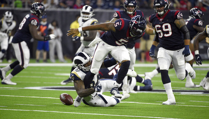Houston Texans quarterback Joe Webb III (5) fumbles the ball as Los Angeles Rams defensive end John Franklin-Myers (94) tackles him during the first half of a preseason NFL football game Thursday, Aug. 29, 2019, in Houston. Houston recovered the fumble. (AP Photo/Eric Christian Smith)