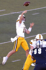 Wyoming quarterback Levi Williams (8) completes a first down pass against Nevada in the first half of an NCAA college football game in Reno, Nev., Saturday, Oct. 24, 2020. (AP Photo/Lance Iversen)