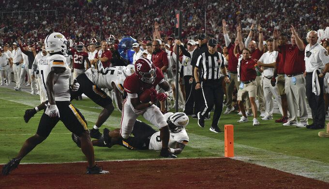 Alabama Crimson Tide Running Back Jase McClellan turns a nine yard pass into a touchdown, beating out two Southern Miss defenders at Bryant Denny Stadium on Saturday, Sept. 25, 2021 in Tuscaloosa, AL. (Hunter Dawkins/The Gazebo Gazette via AP)