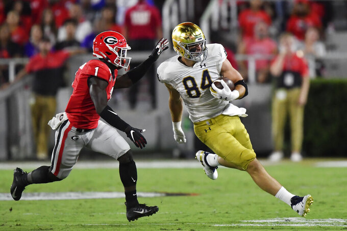 Notre Dame tight end Cole Kmet (84) runs against Georgia defensive back Divaad Wilson (1) during the first half of an NCAA college football game, Saturday, Sept. 21, 2019, in Athens, Ga. (AP Photo/Mike Stewart)