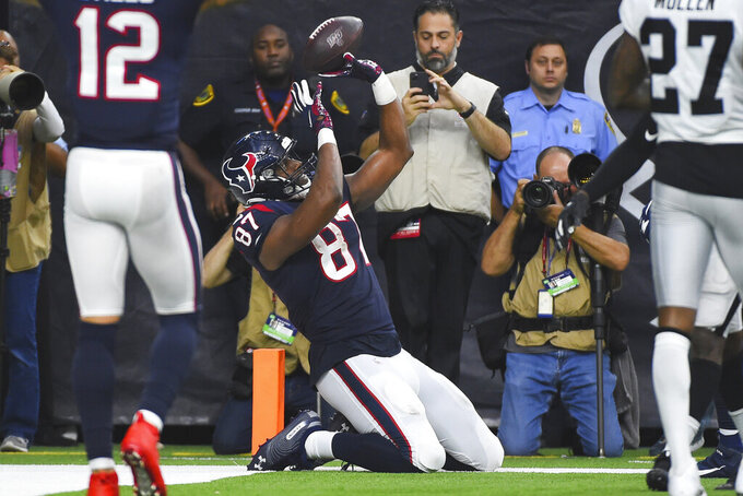 Houston Texans tight end Darren Fells (87) celebrates his touchdown against the Oakland Raiders during the second half of an NFL football game Sunday, Oct. 27, 2019, in Houston. (AP Photo/Eric Christian Smith)