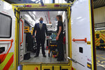 Britain's Prime Minister Boris Johnson, wearing a face mask, talks with a paramedic inside the back of an ambulance during a visit to the headquarters of the London Ambulance Service NHS Trust in London, Monday July 13, 2020. (Ben Stansall/Pool via AP)