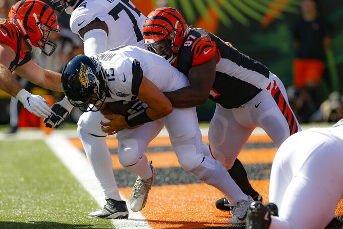 Jacksonville Jaguars quarterback Gardner Minshew (15) is sacked by Cincinnati Bengals defensive tackle Geno Atkins (97) in the first half of an NFL football game, Sunday, Oct. 20, 2019, in Cincinnati. (AP Photo/Gary Landers)