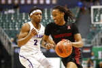 Houston guard Caleb Mills, right, tries to dribble past Portland guard JoJo Walker, left, during the second half of an NCAA college basketball game Sunday, Dec. 22, 2019, in Honolulu. (AP Photo/Marco Garcia)