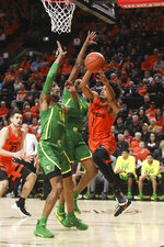 Oregon State's Stephen Thompson Jr. (1) passes from beneath the basket while under pressure from Oregon's Kenny Wooten (14) and Louis King during the first half of an NCAA college basketball game in Corvallis, Ore., Saturday, Feb. 16, 2019. (AP Photo/Amanda Loman)