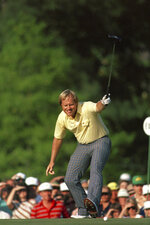 FILE - In this April 13, 1986, file photo, Jack Nicklaus watches his putt drop for a birdie on the 17th hole during the Masters golf tournament at Augusta National in Augusta, Ga. Nicklaus turns 80 on Tuesday, Jan. 21, 2020, and still remains a big part of golf conversations. (AP Photo/Phil Sandlin, File)