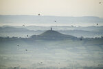 FILE - This Dec. 19, 2017 file photo shows Glastonbury Tor in Glastonbury, England, which is cared for by the National Trust. Britain's National Trust which looks after hundreds of the country's well-loved historic sites, published a report Tuesday Sept. 22, 2020, said 93 of its sites have connections with aspects of the global slave trade or Britain's colonial history. Glastonbury Tor is shown to have links to successful compensation claims as a result of the abolition of slavery,. (Ben Birchall/PA via AP, File)