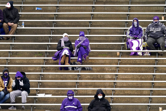 Fans sit in social distanced groups during the second half of an NCAA college football game between Kansas State and Kansas Saturday, Oct. 24, 2020, in Manhattan, Kan. (AP Photo/Charlie Riedel)