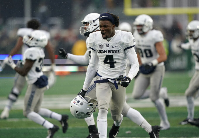 Utah State safety Aaron Wade celebrates the team's 29-24 win against Colorado State during the second half of an NCAA football game Saturday, Nov. 17, 2018, in Fort Collins, Colo. (AP Photo/Jack Dempsey)