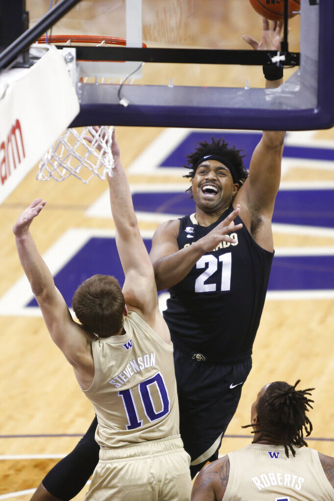 Colorado's Evan Battey (21) shoots over Washington's Erik Stevenson during the first half of an NCAA college basketball game Wednesday, Jan. 20, 2021, in Seattle. (AP Photo/Joe Nicholson)